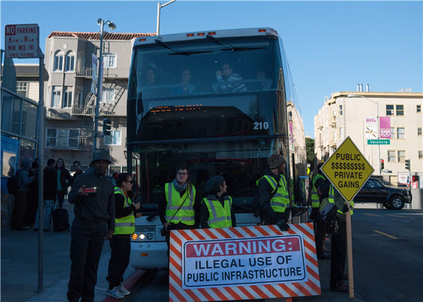 Corporate bus protests by those upset with free rides from large corporations like Google, Facebook, Yahoo, and Genetech.