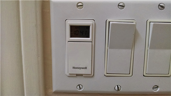 A Honeywell Programmable light switch. Capable of 7 different schedules!