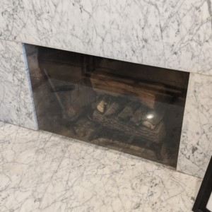 Clear fireplace cover to stop cold drafts of air.