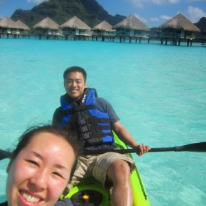 Kayaking on the open water by the over water bungalows in Le Méridien.