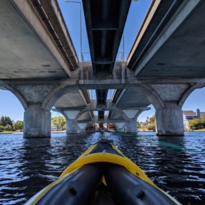 Water sports such as kayaks, stand up paddle board, wind surfing in a Foster City lagoon.